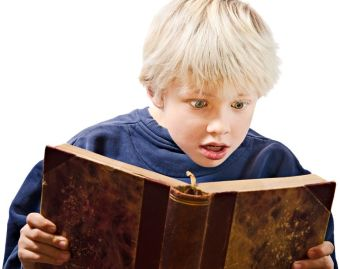 11817949 - young boy reading excited in an old book